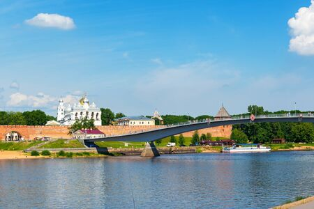 NOVGOROD THE GREAT, RUSSIA - JUNE 12, 2014: Panorama: Volkhov river and the ancient Kremlin. UNESCO recognised Novgorod as a World Heritage Site in 1992.