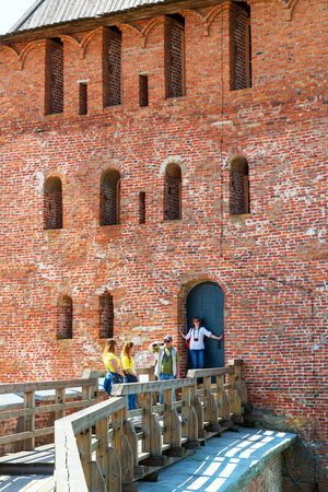 veliky: NOVGOROD THE GREAT, RUSSIA - JUNE 12, 2014: Tourists visit the tower of the Kremlin. UNESCO recognised Novgorod as a World Heritage Site in 1992. Editorial