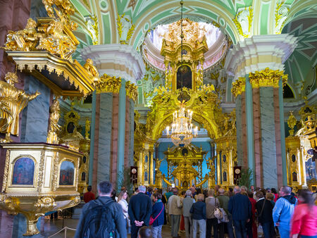 ST PETERSBURG, RUSSIA - JUNE 13, 2014: Tourists visit the Peter and Paul Cathedral. Russian emperors are buried here.