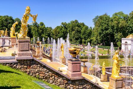 petrodvorets: ST PETERSBURG, RUSSIA - JUNE 15, 2014: Peterhof Palace (Petrodvorets) with Grand Cascade. The Peterhof Palace included in the UNESCOs World Heritage List.