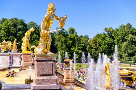 petergof: ST PETERSBURG, RUSSIA - JUNE 15, 2014: Peterhof Palace (Petrodvorets) with Grand Cascade. The Peterhof Palace included in the UNESCOs World Heritage List.