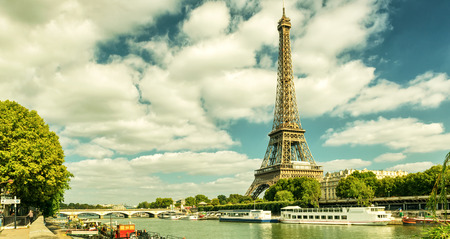 tourist attractions: Paris skyline with The Eiffel tower, France. Vintage photo.