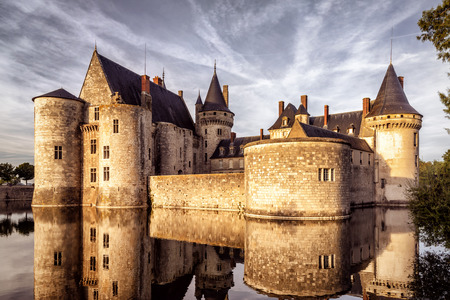 sully: The chateau of Sully-sur-Loire at sunset, France. This castle is located in the Loire Valley, dates from the 14th century and is a prime example of medieval fortress. Editorial