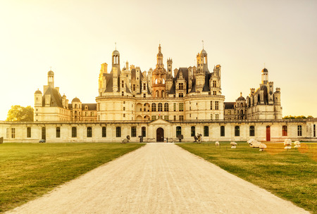 chambord: The royal Chateau de Chambord at sunset, France. This castle is located in the Loire Valley, was built in the 16th century and is one of the most recognizable chateaux in the world. Editorial