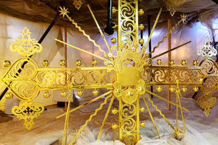 gilded: Reconstruction of a gilded cross on the top of the dome of the Orthodox church