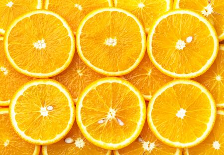 Tranches d'orange frais, fond orange Banque d'images - 38865041