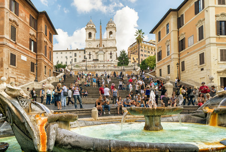 ROME - CIRCA OCTOBER 2012: The Spanish Steps, seen from Spanish square (Piazza di Spagna). Fountain of the Ugly Boat by Bernini in the foreground. The Spanish Steps are the widest staircase in Europe.