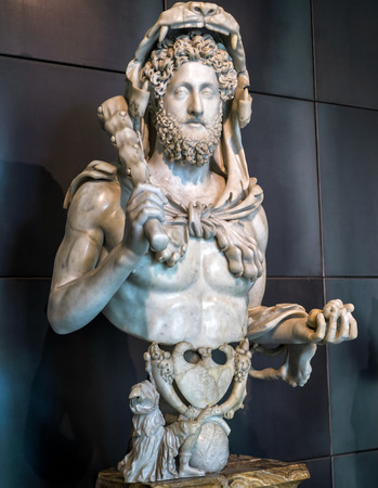 display figure: ROME, ITALY - OCTOBER 3, 2012: Antique statue in the Capitoline Museum: the emperor Commodus as Hercules. Open to the public in 1734, the Capitoline Museums are considered the first museum in the world.