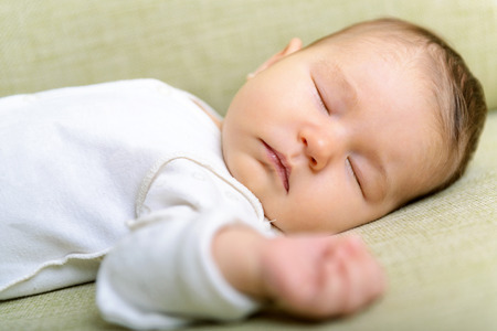 peacefully: Newborn baby is sleeping peacefully at home