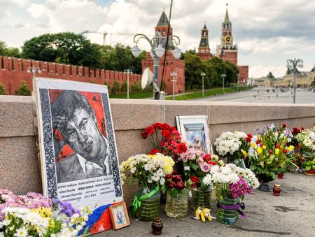 boris: MOSCOW - JULY 10, 2015: Flowers at the place of murder of the russian opposition leader Boris Nemtsov, near Kremlin. Boris Nemtsov was killed in the night of Feb 28, 2015 in center of Moscow.