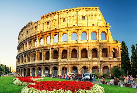 vibrance: ROME - OCTOBER 4, 2012: The Colosseum (Coliseum) at sunset. The Colosseum is a major tourist attraction in Rome.
