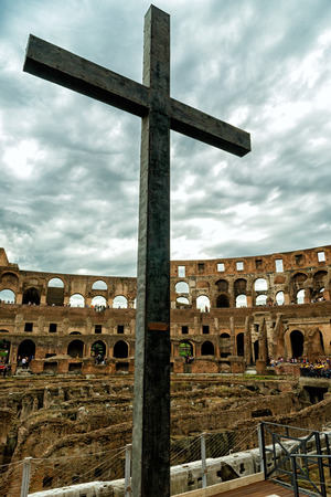 emporium: ROME - OCTOBER 1, 2012: Cross in the Coliseum (Coliseum). The Colosseum is an important monument of antiquity and is one of the main tourist attractions of Rome. Editorial