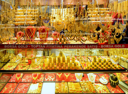 kapalicarsi: ISTANBUL - MAY 27, 2013: Oriental gold jewelry sold in the Grand Bazaar. The Grand Bazaar is the oldest and the largest covered market in the world, with 61 covered streets. Editorial