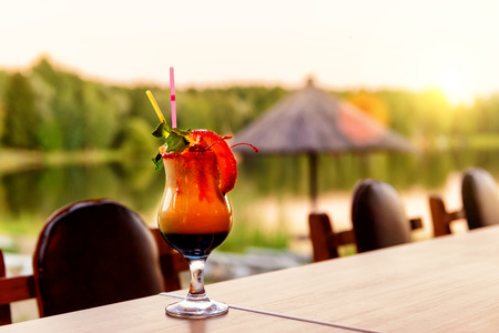 A beautiful cocktail on the beach at sunset