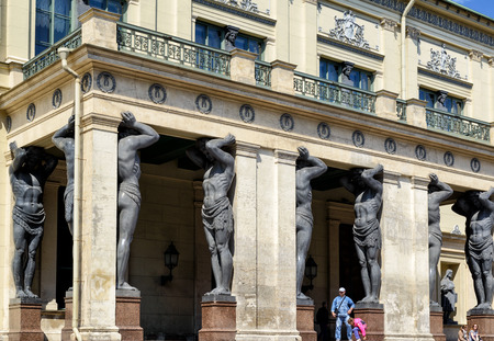 atlantes: ST PETERSBURG, RUSSIA - JUNE 14, 2014: Portico of the New Hermitage with atlantes. The Hermitage is one of the largest and oldest museums in the world.