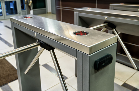 The tripod turnstile with electronic card reader iis closed