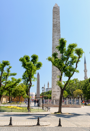 hippodrome: ISTANBUL - MAY 26, 2013: Ancient Hippodrome at Sultan Ahmet square. Walled Obelisk of Constantine (foreground) and Obelisk of Pharaoh Tutmoses III (behind).