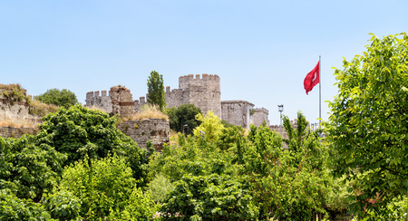 constantinople ancient: The Yedikule Fortress (Castle of Seven Towers) and ancient walls of Constantinople with Turkish flag in Istanbul, Turkey
