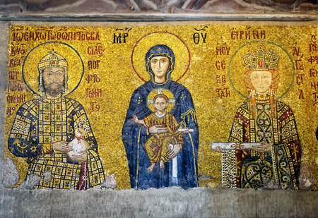 ISTANBUL - MAY 25, 2013: Ancient mosaic in Hagia Sophia: Virgin Mary with Christ and the imperial family. Hagia Sophia is the greatest monument of Byzantine Culture. It was built in the 6th century. 新闻类图片