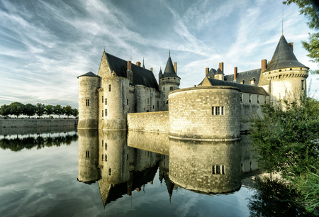 sully: The chateau of Sully-sur-Loire in the evening, France. This castle is located in the Loire Valley, dates from the 14th century and is a prime example of medieval fortress.