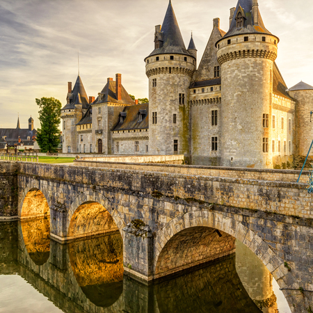 The chateau of Sully-sur-Loire at suset, France. This castle is located in the Loire Valley, dates from the 14th century and is a prime example of medieval fortress. Editöryel