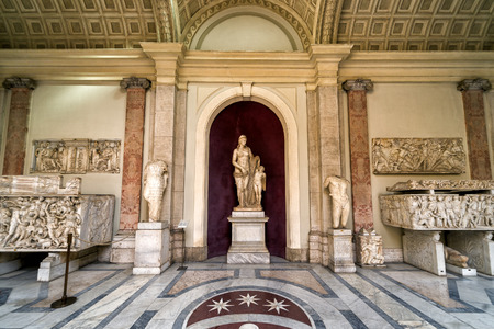 VATICAN - MAY 14, 2014: Antique statues in the Vatican Museum. Statue of Venus in the center. Vatican City, Rome, Italy.
