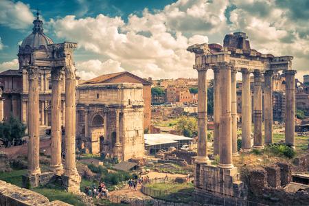severus: Roman Forum in Rome, Italy. Ruins of Temple of Saturn and Arch of emperor Septimius Severus.