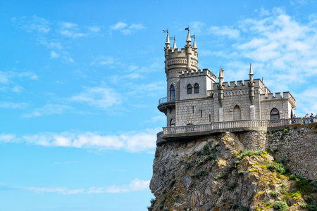 alupka: The famous castle Swallows Nest on the rock in the Black Sea in Crimea, Russia. This castle is a symbol of Crimea.