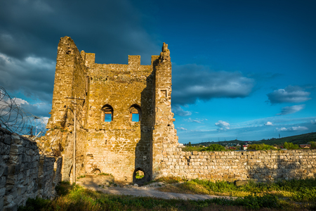genoese: Ruins of the Genoese fortress in the city of Feodosia at sunset, Crimea, Russia