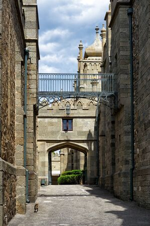 alupka: ALUPKA, RUSSIA - MAY 20, 2016: Shuvalov Passage - a medieval street in the Vorontsov Palace. This palace is one of the attractions of the Crimea. Editorial