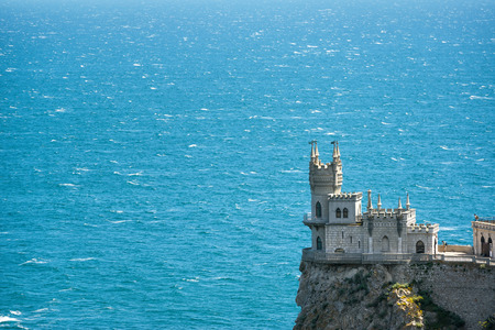 alupka: The famous Swallows Nest castle on the rock in the Black Sea in Crimea, Russia. Seascape background.