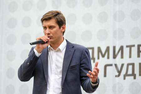 voters: MOSCOW - JULY 27, 2016: State Duma deputy Dmitry Gudkov speaks to voters. Dmitry  Gudkov is one of the leaders of the opposition in Russia.