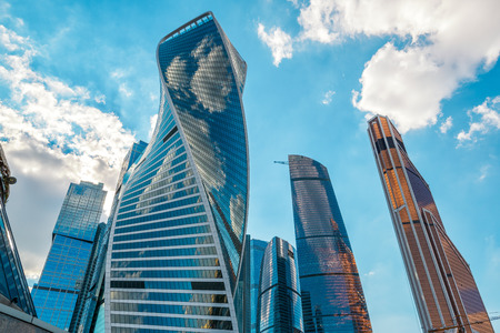 international business center: MOSCOW - AUGUST 10, 2016: Skyscrapers in Moscow-city (Moscow International Business Center). Evolution Tower in the foreground. Low angle view.