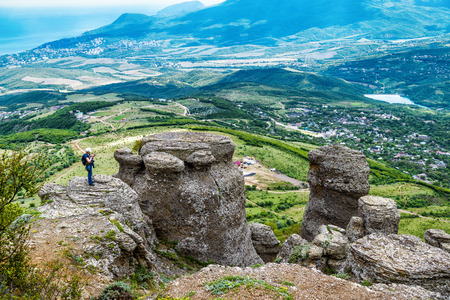 ghost rock: Traveler on the rock formation of the Demerdji mountain. Valley of Ghosts. Landscape of Crimea, Russia. Stock Photo