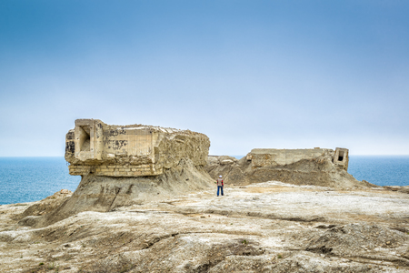 The post apocalyptic view. Excavated fortifications from the Second World War in Feodosia, Crimea, Russia. Traveler and ruins. Stock Photo
