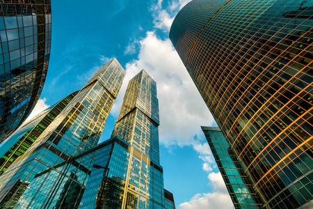international business center: MOSCOW - AUGUST 10, 2016: Skyscrapers in Moscow-City (Moscow International Business Center). Low angle view.