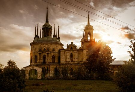sacred trinity: Nativity church in the town of Bykovo near Moscow at sunset, Russia Stock Photo