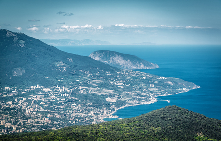 Aerial view of city of Yalta from the Mount Ai-Petri. Ayu-Dag, or Bear Mountain, in the background. Landscape of Crimea, Russia. Stock Photo