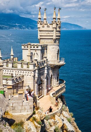 alupka: CRIMEA - MAY 18, 2016: The famous castle Swallows Nest on the rock in the Black Sea. This castle is a symbol of Crimea.