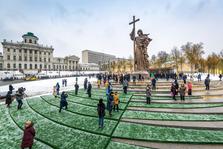 MOSCOW, RUSSIA - NOVEMBER 4, 2016: Monument to Holy Prince Vladimir the Great on Borovitskaya Square near the Kremlin. Vladimir is credited with the introduction of Orthodox Christianity. People visit the monument on the opening day.
