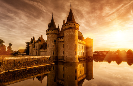The chateau of Sully-sur-Loire at sunset, France. This castle is located in the Loire Valley, dates from the 14th century and is a prime example of medieval fortress. Editorial