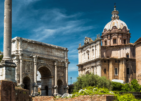 severus: Triumphal arch of the emperor Septimius Severus and medieval church of Santi Luca e Martina in the Roman Forum, Rome, Italy Stock Photo
