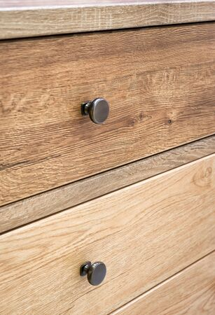 drawers: Wooden furniture detail with drawers