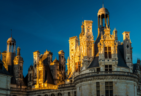 the loire: The royal Chateau de Chambord at sunset, France. This famous castle is located in the Loire Valley, was built in the 16th century and is one of the most recognizable chateaux in the world.