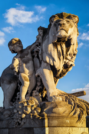 Statue of a lion on the Pont Alexandre III in Paris, France. This bridge was named after russian Tsar Alexander III. Stock Photo