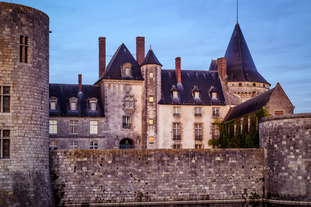 sully: The chateau of Sully-sur-Loire in the evening, France. This castle is located in the Loire Valley, dates from the 14th century and is a prime example of medieval residence.