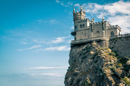 The castle Swallows Nest on the rock at the blue sky background in Crimea, Russia. This castle is a symbol of Crimea.