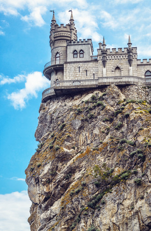 Swallows Nest castle on the rock over the Black Sea in Crimea, Russia. Low angle view. This castle is a symbol of Crimea.