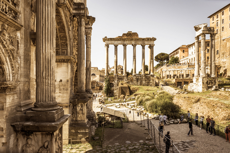 severus: ROME, ITALY - MAY 15, 2014: Arch of Emperor Septimius Severus and Temple of Saturn in the distance at the Roman Forum.