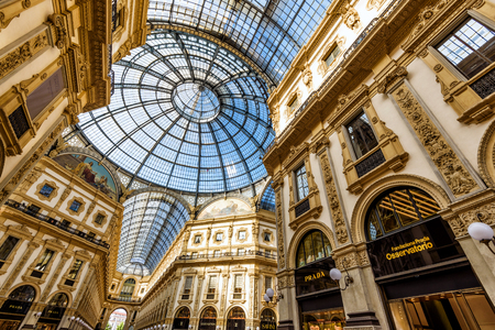 prada: MILAN, ITALY - MAY 16, 2017: Prada adn other stores in the Galleria Vittorio Emanuele II in central Milan. This gallery is one of the worlds oldest shopping malls. Editorial